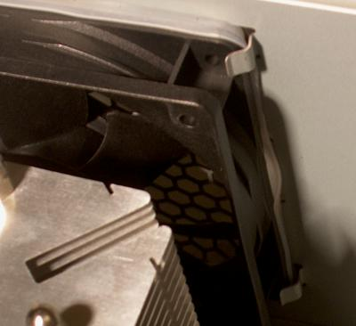 bend the top case fan mounting tabs to accommodate gasket